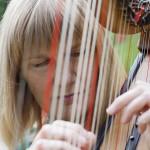 Laurelle through harp strings